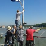 How many people do you need to take the burgee down?